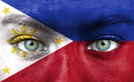 philippines flag: Human face painted with flag of Philippines