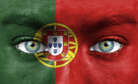 Human face painted with flag of Portugal Stock Photo - 14256252
