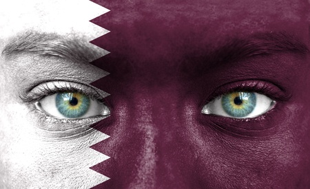 Human face painted with flag of Qatar photo