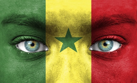 Human face painted with flag of Senegal Stock Photo