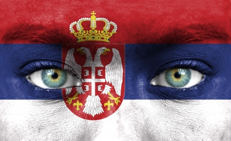 Human face painted with flag of Serbia photo