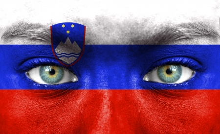 Human face painted with flag of Slovenia photo