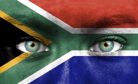 Human face painted with flag of South Africa Stock Photo