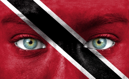 national flag trinidad and tobago: Human face painted with flag of Trinidad and Tobago