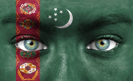 turkmenistan: Human face painted with flag of Turkmenistan