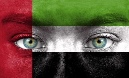 Human face painted with flag of United Arab Emirates photo
