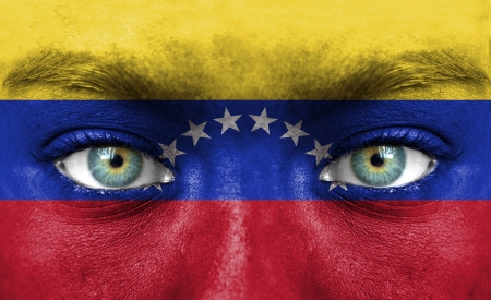 nationalistic: Human face painted with flag of Venezuela