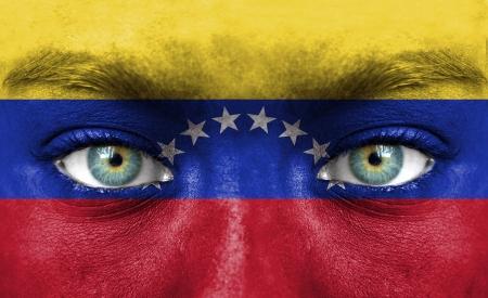 venezuela: Human face painted with flag of Venezuela