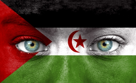 western european: Human face painted with flag of Western Sahara