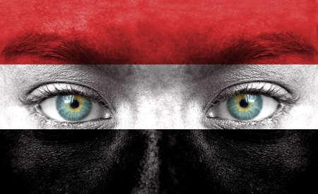 yemen: Human face painted with flag of Yemen Stock Photo