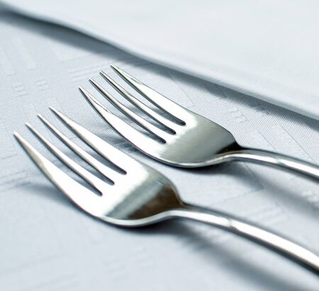 Forks set on restaurant table macro shot photo
