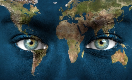 futuristic nature: Human face painted with planet earth Stock Photo