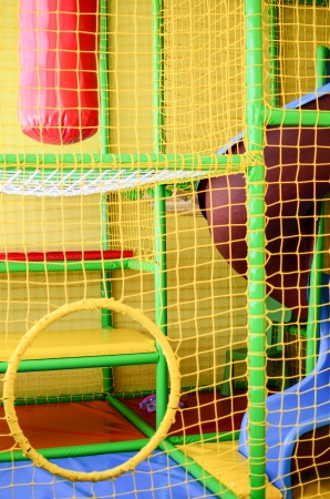 Kid playroom with safety net photo