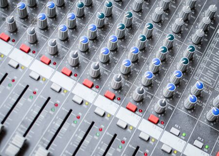 Music mixer desk closeup photo