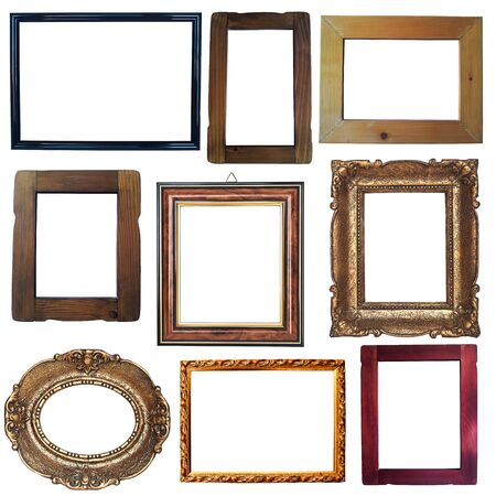 Collection of vintage wooden and golden empty frames isolated on white background photo
