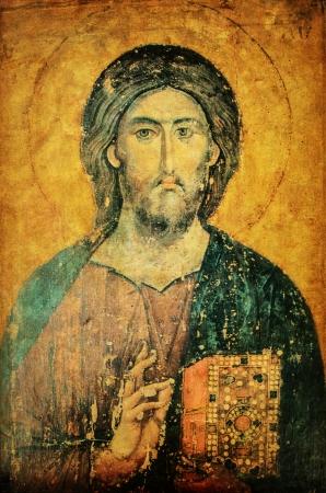 손에 성경과 예수 그리스도의 아이콘