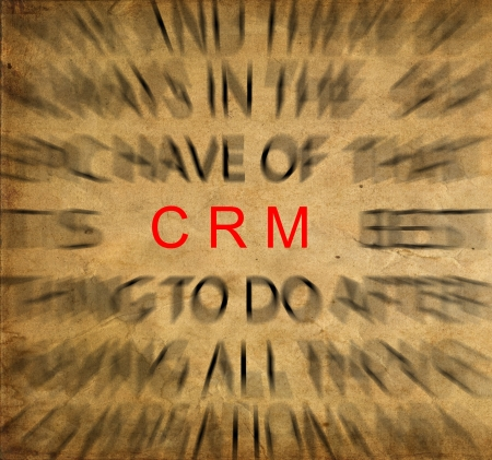 Blured text on vintage paper with focus on CRM (Customer Relationship Management) photo