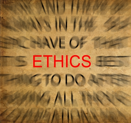 business ethics: Blured text on vintage paper with focus on ETHICS Stock Photo