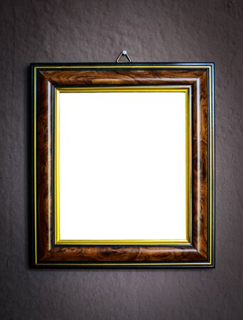 Wooden frame on grunge wall background photo