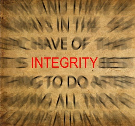uprightness: Blured text on vintage paper with focus on INTEGRITY Stock Photo