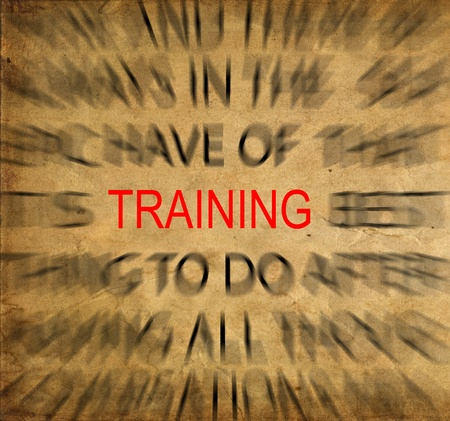 training and development: Blured text on vintage paper with focus on TRAINING Stock Photo