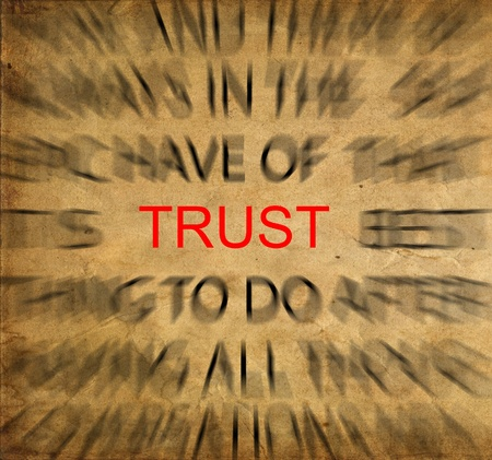 Blured text on vintage paper with focus on TRUST photo