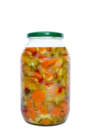 Preserved vegetables in glass jar isolated on white background photo