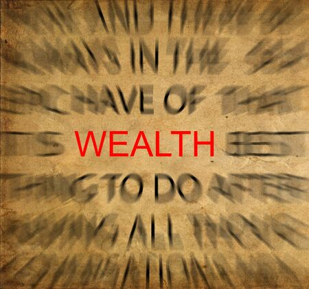 combined effort: Blured text on vintage paper with focus on WEALTH Stock Photo