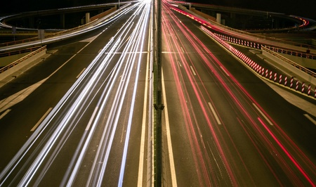 velocity: Highway light trails Stock Photo