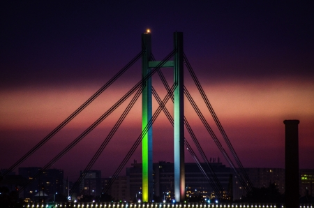 Beautiful image of bridge silhouette at midnight photo