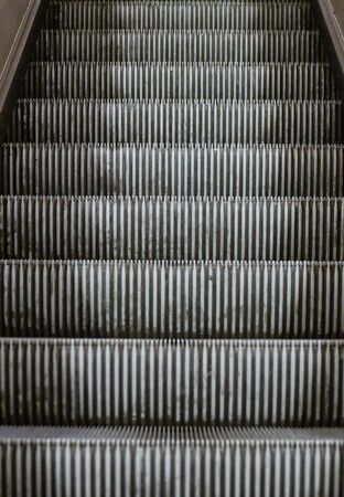 Abstract view on escalator staircase photo