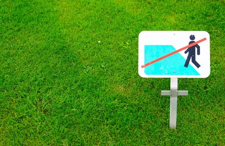 new rules: No walking on grass warning sign