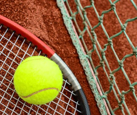 Tennis ball and racquet closeup photo