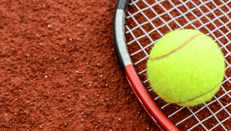 tennis clay: Tennis ball and racquet on a tennis clay court
