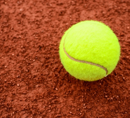 Tennis ball on a tennis clay court  photo