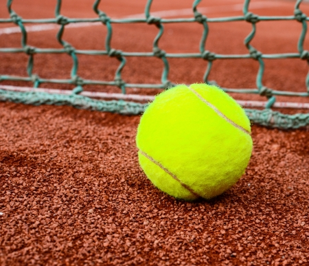 Tennis ball on clay photo