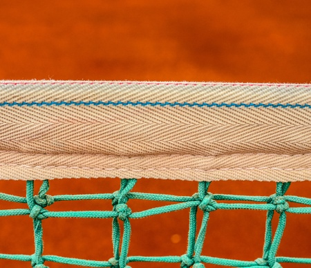 Net of tennis court on clay court photo