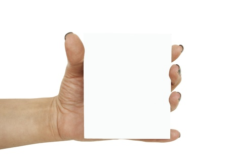 Hand holding blank photograph isolated on white photo
