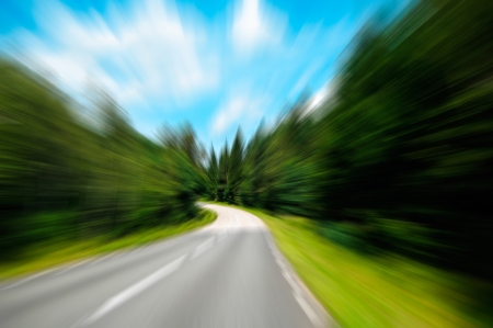 Highway in forest in motion blur Stock Photo - 14844830