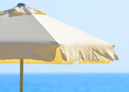 Beach umbrella against the sea and sky photo