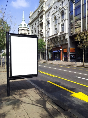 Blank billboard on city bus station photo