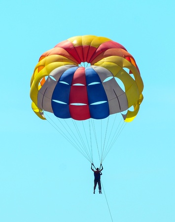 Extreme sports - Parachute at over sky photo