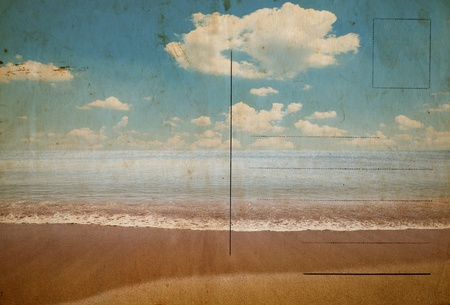 Reverse side of an old stained postcard with image of sandy tropical beach photo