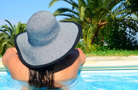 Woman resting in pool area Stock Photo - 15291040