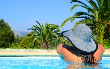Lady with straw hat enjoying sun photo