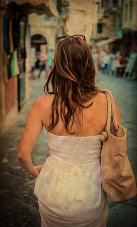 Vintage image of woman in white dress - Rear view photo