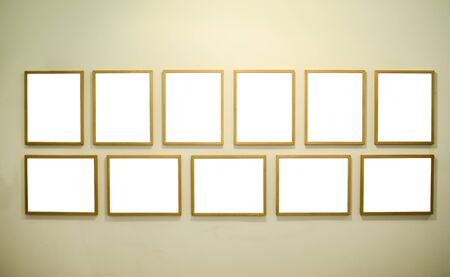 Empty picture frames on gallery wall photo