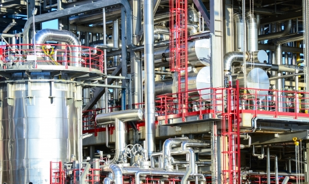 pressurized: Power plant with various pipes Stock Photo