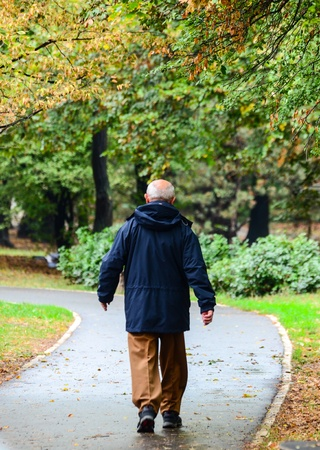Senior man walking in forest Stock Photo - 15918524