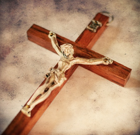 Cross with crucified Jesus Christ in vintage style photo